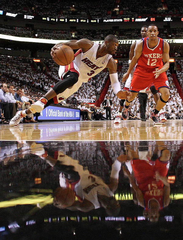 Playoffs Art Print featuring the photograph Evan Turner and Dwyane Wade by Mike Ehrmann