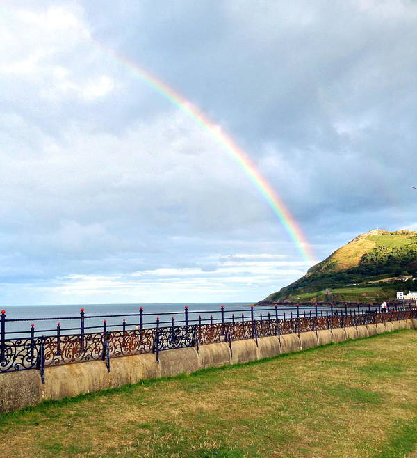 Rainbow Over Bray Head Art Print featuring the digital art  Rainbow Over Bray Head by Desmond Joseph Reilly