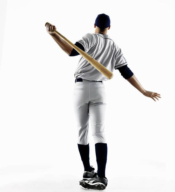 Baseball Cap Art Print featuring the photograph Baseball Player Hitting Home Run From by Patrik Giardino