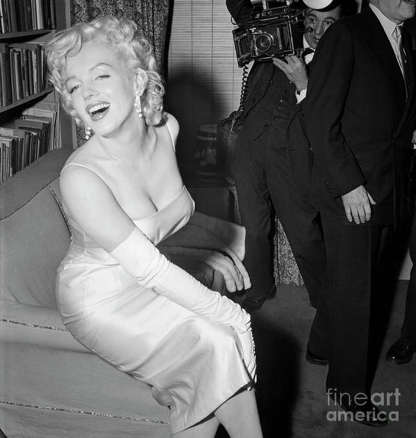 People Art Print featuring the photograph Marilyn Monroe Posing For A Photographer by Bettmann
