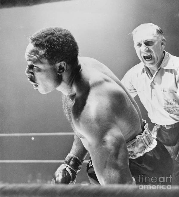Mature Adult Art Print featuring the photograph Referee Counting As Boxer Archie Moore by Bettmann