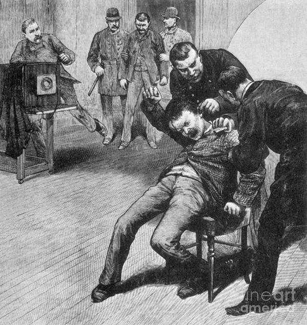 History Print featuring the photograph Anarchist Being Held Down For Mug Shot by Photo Researchers