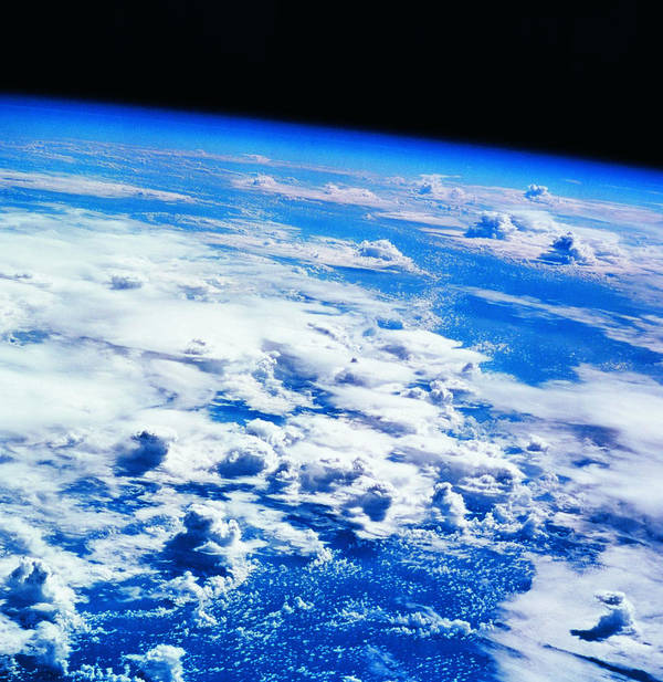 Square Art Print featuring the photograph Clouds Over Earth Viewed From A Satellite by Stockbyte