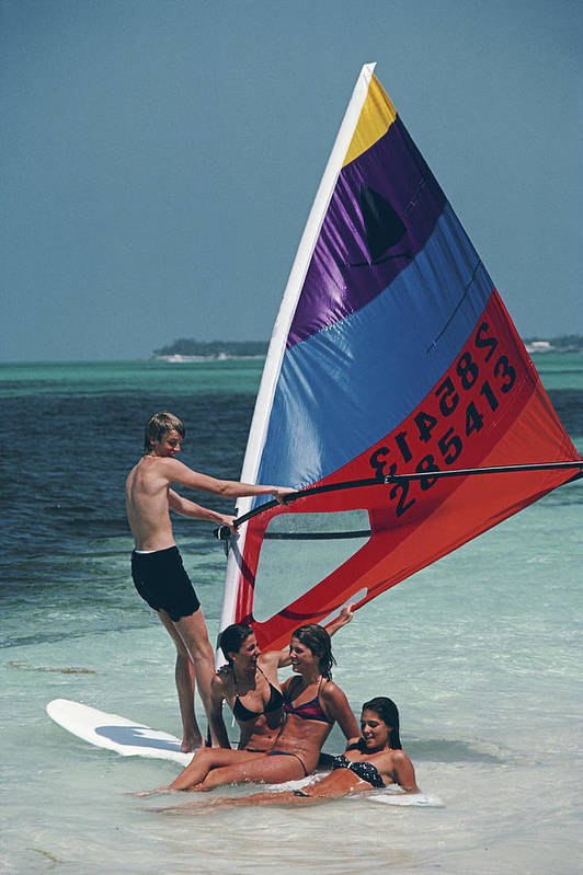 Young Men Art Print featuring the photograph Bahamas Windsurfing by Slim Aarons