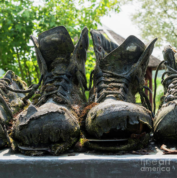 Old Art Print featuring the photograph Row Of Old Leather Worn Out Shoes by Compuinfoto