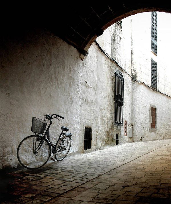 Tranquility Art Print featuring the photograph Bicycle Leaning Wall by Antonio R. Ramos