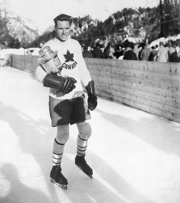 The Olympic Games Art Print featuring the photograph Canadian Hockey Captain With Olympic by Bettmann