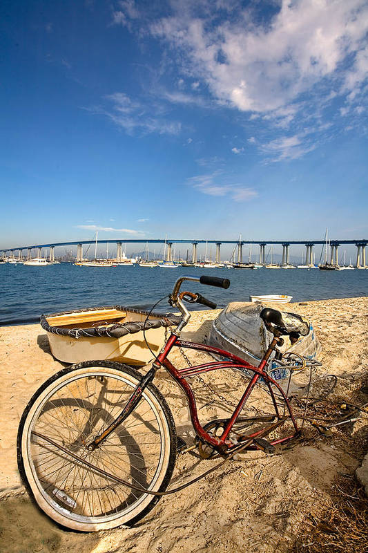 Beach Art Print featuring the photograph Bike And A Brdige by Peter Tellone