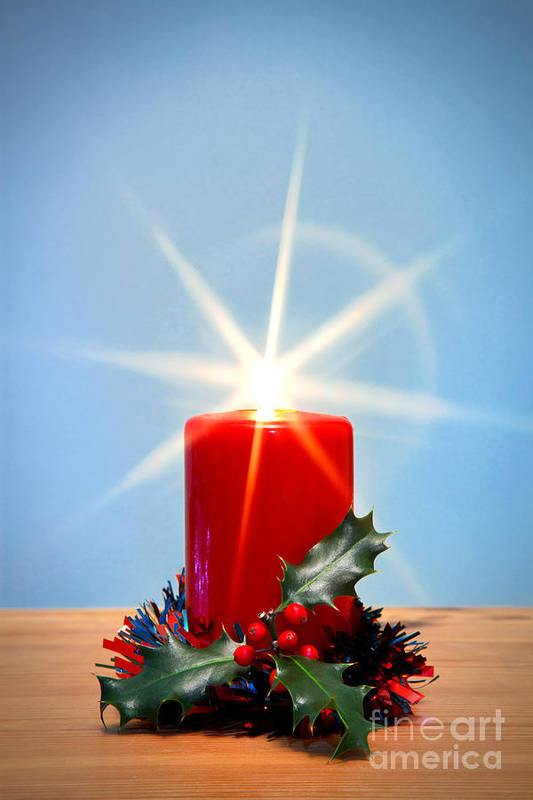 Christmas Art Print featuring the photograph Christmas Candle With Starburst And Holly. by Richard Thomas