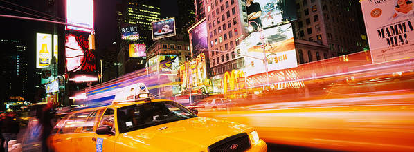 Photography Art Print featuring the photograph Yellow Taxi On The Road, Times Square by Panoramic Images