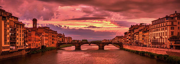 Panoramic view of Saint Trinity Bridge from Ponte Vecchio at sunset