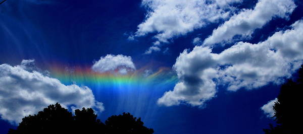 Heavens Rainbow Art Print featuring the photograph Heavens Rainbow by Linda Sannuti