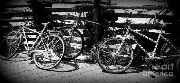 Bike Art Print featuring the photograph Black And White Leaning Bikes by Emily Kelley