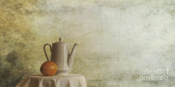 Table Art Print featuring the photograph A Jugful Tea And A Orange by Priska Wettstein
