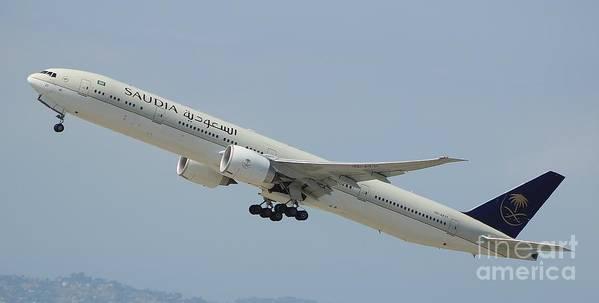 Saudi Boeing 777-er Art Print featuring the photograph Saudia B-777 by John Linder
