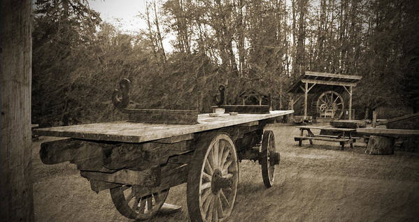 Old Wagon With Antique Water Wheel Art Print featuring the photograph Old Wagon With Antique Water Wheel by Tina Wentworth