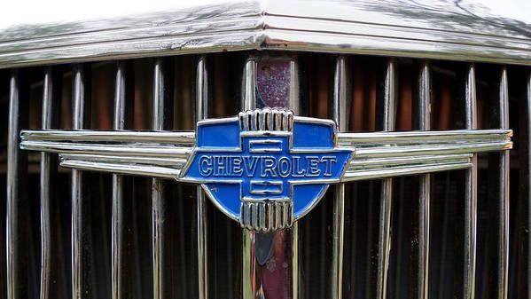 Chevrolet Art Print featuring the photograph Vintage Chevrolet Grille Emblem by Alan Hutchins