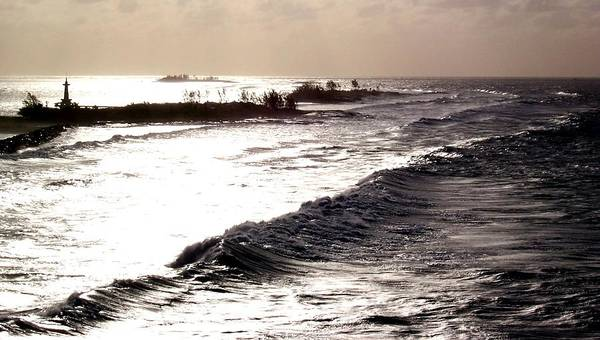 Silver Waves Art Print featuring the photograph Distant Lighthouse by Linda Cole