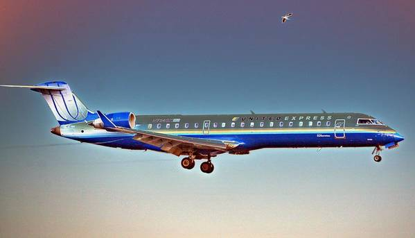 Aviation Art Print featuring the photograph Surreal United Express by Fraida Gutovich