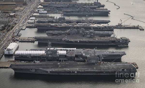 Military Art Print featuring the photograph Aircraft Carriers In Port At Naval by Stocktrek Images