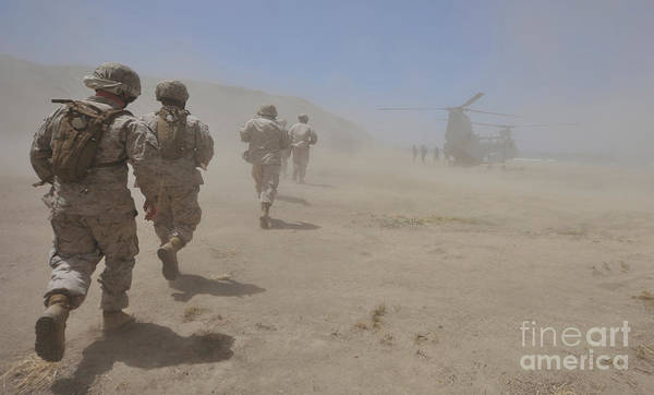 Marine Expeditionary Unit Art Print featuring the photograph Marines Move Through A Dust Cloud by Stocktrek Images