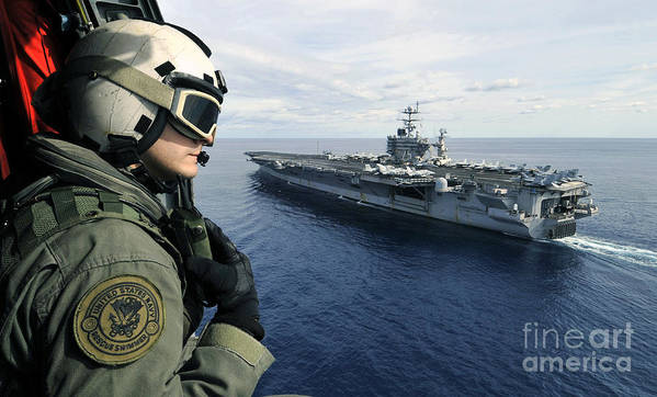 Aircraft Carrier Art Print featuring the photograph Naval Air Crewman Conducts A Visual by Stocktrek Images