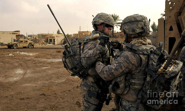Iraq Art Print featuring the photograph Soldiers Help One Another by Stocktrek Images
