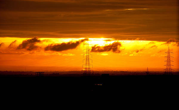 Sunset Art Print featuring the photograph Three-tier Sunset by Vidhya Narayanan