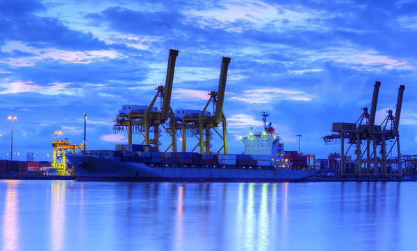 Bangkok Art Print featuring the photograph Container Cargo Freight Ship With Working Crane Bridge In Shipya by Anek Suwannaphoom