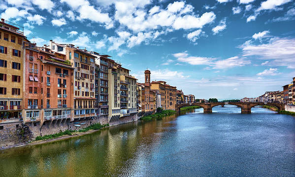 Picturesque buildings and the Arno river in Florence