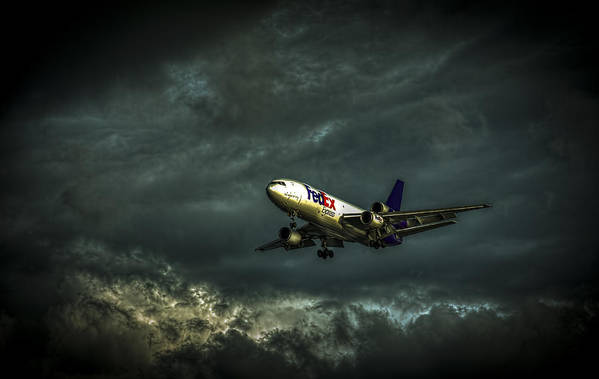 Jets Art Print featuring the photograph Foul Weather Fedex by Marvin Spates