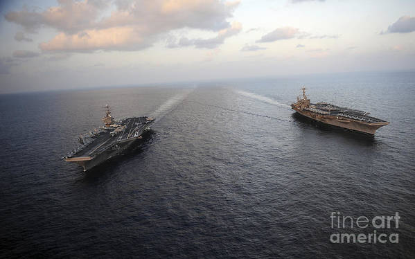 On The Move Art Print featuring the photograph Nimitz-class Aircraft Carriers Transit by Stocktrek Images