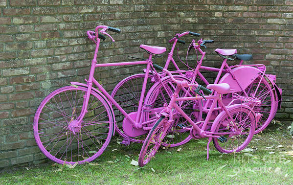 Purple Art Print featuring the photograph Pink Painted Bikes And Old Wall by Compuinfoto