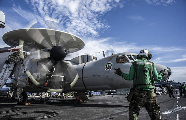 Expertise Art Print featuring the photograph An Aircraft Director Directs An E-2c Hawkeye Aboard Uss George Washington. by Stocktrek Images