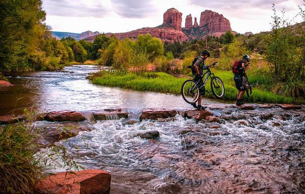 Cathedral Crossing Art Print featuring the photograph Mountain Bikers Crossing Cathedral Falls by Linda Pulvermacher