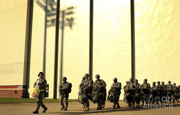 Men Art Print featuring the photograph U.s. Army Soldiers Prepare To Board by Stocktrek Images