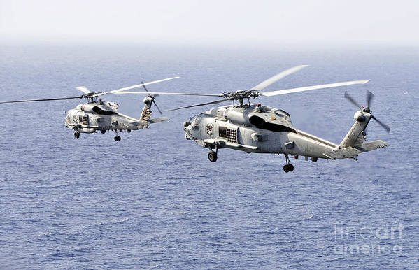 Mh-60 Seahawk Art Print featuring the photograph An Airborne Change Of Command by Stocktrek Images
