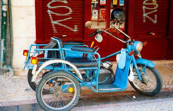Portugal Art Print featuring the photograph Portuguese Wheels by Andrea Simon