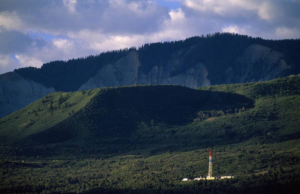Outdoors Print featuring the photograph A Gas Drilling Rig At The Foot by Joel Sartore