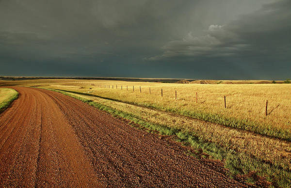 Roadside Art Print featuring the digital art Storm Clouds Along A Saskatchewan Country Road by Mark Duffy