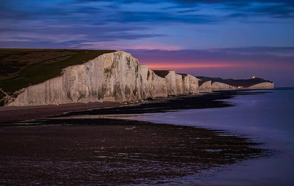 Seven Sisters Cliffs Art Print featuring the photograph Seven Sisters Cliffs In England Seen At Night. by George Afostovremea