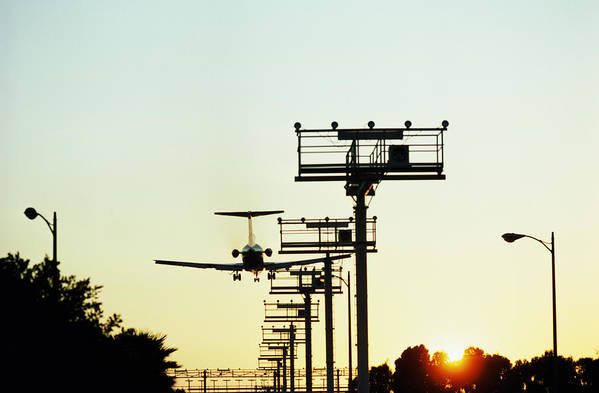 Aeroplane Landing, Landing Lights In Foreground, Sunset Art Print