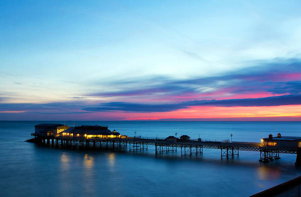 Amusements Print featuring the photograph Cromer Pier At Sunrise On English Coast by Fizzy Image