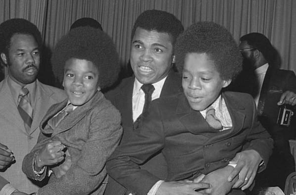 Ali Art Print featuring the photograph Muhammad Ali With Young Michael Jackson by Brian Douglas