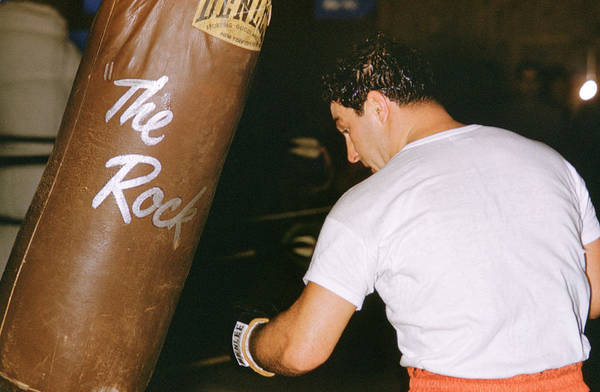 Marvin Newman Art Print featuring the photograph Rocky Marciano Vs. Heavy Bag by Retro Images Archive