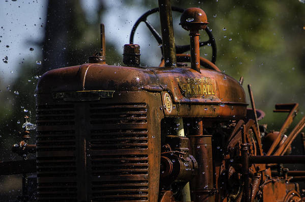 Texas Art Print featuring the photograph Wet Red Tractor by Alan Roberts