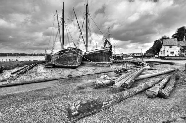 Butt And Oyster Art Print featuring the photograph Boats And Logs At Pin Mill by Gary Eason