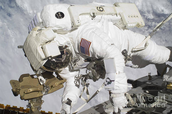 Components Art Print featuring the photograph An Astronaut Participates In A Session by Stocktrek Images