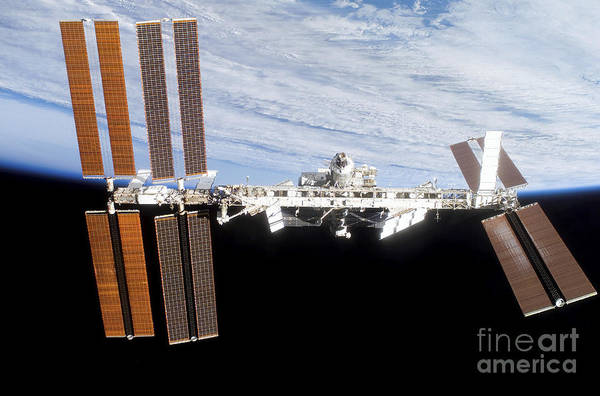 Blue Art Print featuring the photograph International Space Station by Stocktrek Images