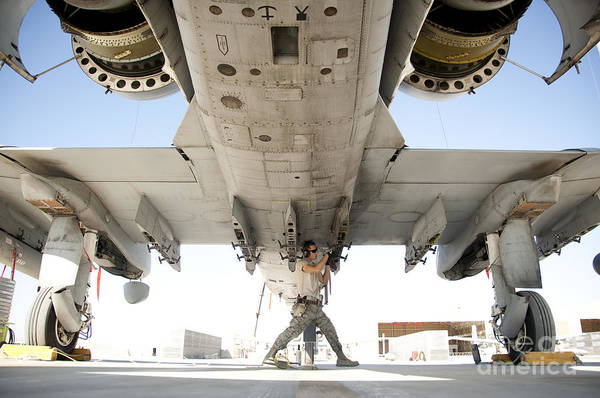 Kandahar Art Print featuring the photograph Airman Performs An Inspection by Stocktrek Images